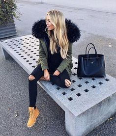 Fur Parka, Black top, Black ripped jeans, Timberlands