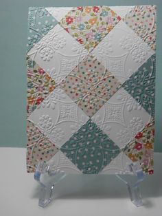 handmade greeting card ... patchwork quilt built of squares on end ... white squares show of the beautiful all over design of embossing folder texture used to embed the parts ... lovely small patterned papers ...