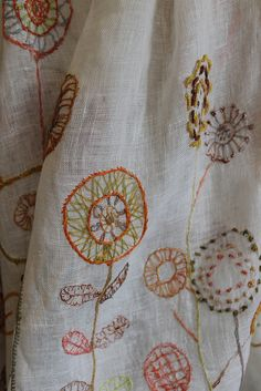 Beautiful hand embroidery on this sheer linen Sophie Digard wrap.  http://thecreatory.com/journal/all-about-linen-new-scarves-from-sophie-digard/