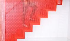 amazing-bespoke-red-hot-perforated-steel-suspended-staircase-diapo-12-interactive.jpg