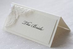 Cream and pearl lace place name cards #nordstromweddings
