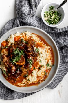 This classic Milanese dish is made up of braised veal shanks in a white wine and tomato-based sauce that is served over a bed of saffron risotto and gremolata. Beef Recipes, Chicken Recipes, Cooking Recipes, Italian Recipes, Osso Buco Recipe, Risotto, Red Spice, Slow Cooked Beef, How To Grill Steak