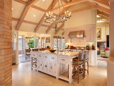 Cool open-concept kitchen in mountain-view home in Ross, CA, that's on the market for $10,800,000! It's got vaulted ceilings, a 6-burner Viking range, Sub-Zero refrigerator, and a wood-fired pizza oven.