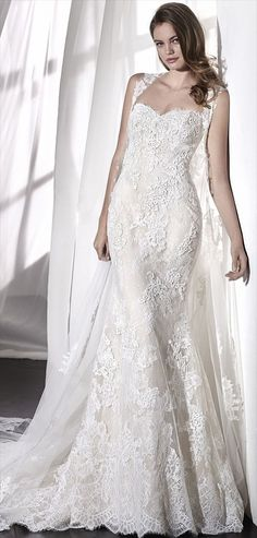 San Patrick 2018 Elegant low waist mermaid wedding dress that combines a sweetheart neckline with an open back. A design in embroidered tulle and lace with beaded appliqués. A very romantic dress that is completed by a fabulous detachable cape in embroidered tulle and beaded lace to match the dress.