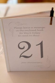 Unique table number idea.  Everyone at table writes a note for the bride and groom to read on the corresponding anniversary! Photo by Erin Keough photography - http://www.erinkeough.com