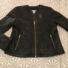 NWT Cole Haan Signature Quilted Jacket Black Cole Haan Quilted Jacket with Gold Hardware.  Gold Zipper Closure.  Gold Zippered Pockets.  Washable!  Face: Polyurethane.  Back, Lining, & Fill: Polyester.  Very soft! Cole Haan Jackets & Coats Utility Jackets