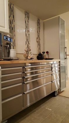 Love it or leave it? This rolling tool chest used as a storage unit in the kitchen.