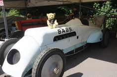 Gino Bear with the famous car Babs. Originally built and driven by John Parry-Thomas, she was powered by a 27 litre aero-engine. She was used to break the landspeed record at 171.02 mph. Buried in sand for 40 odd years until she was finally excavated and restored.
