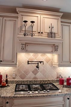 Color of Cabinets and trim on top of cabinets, back splash tile, counter and Mantel over Stove....: