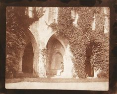 """William Henry Fox Talbot, """"Reverend Calvert Jones Seated in the Cloisters, Laycock Abbey"""", 1847. Salted paper print, calotype negative."""