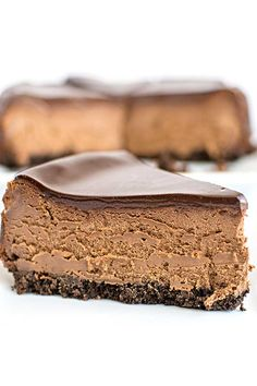 A classic and traditional chocolate cheesecake with a chocolate graham cracker crust and topped with a creamy chocolate ganache.