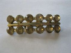 """brooch pin gold colored 12 cut stones glass ? 1 3/8"""" wide yellowed old vintage"""