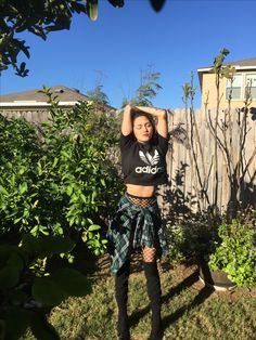 Adidas cropped hoodie, flannel, high waisted denim shorts, fishnet tights, and black boots Instagram @sienna_hunter_