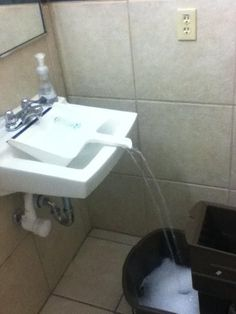 Use a Dustpan to Fill a Container With Water: If you have a container that can't fit in your sink, carefully position a dustpan in a way that will funnel the water into the container below.  Source: imgur.com