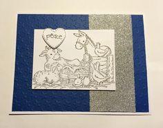 Manger scene on silver glitter on star embossed navy handmade Christmas card.