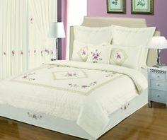 Country Classic Quilted Duvet Cover Set.  The Country Classic is a quilted duvet cover set with a pair of matching pillow cases included. This is a classic duvet cover with floral embroidery and crochet detail on Cream.