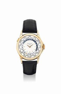 Patek Philippe. A fine 18K gold automatic world time wristwatch. circa 2001. #watch #ChristiesWatches