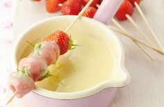 White chocolate fondue with strawberry skewers
