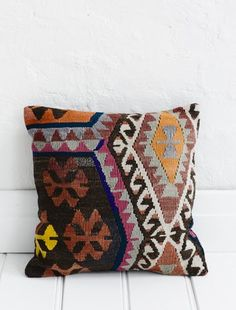 http://naturalmoderninteriors.blogspot.com.au/2013/08/recycled-fabric-cushion-ideas.html | Recycled Fabric Cushion Ideas. Recycled Turkish Kilim cushion.