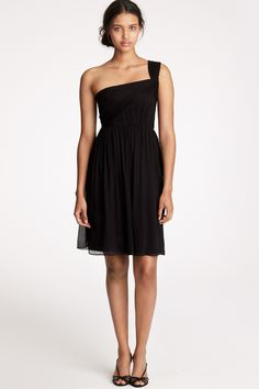 One shoulder silhouette with a pleated, loose bodice and a flowing skirt.