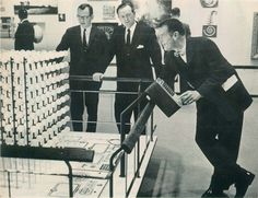 Charles Eames talks with some IBM executives about one of the models in the Eames Office MATHEMATICA exhibition, sponsored by IBM