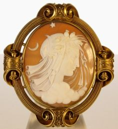 A Victorian Carved Shell Cameo Depicting A Classical Maiden Within A Scrolled, Wire And Bead Decorated Surround