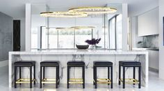 Absolutely in love with this Two Polished Brass Prometheus II light by Christopher Boots. Custom-designed to float over the Kitchen worktop, complimented with a custom ceiling plate that appears to the reflective the suspended pendants. Kitchen Benches, Kitchen Decor, Christopher Boots, Contemporary Chandelier, Kitchen Worktop, Interior Design Studio, Decoration, Contemporary Furniture, Kitchen Remodel