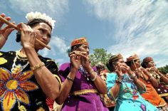 Basri: Some women play a bamboo flute at the opening celebration of the Lindu Lake Festival in the Tomado Village, Sigi district, Central Sulawesi province, December 5, 2009. Bamboo music as it is played every special celebrations in the region.