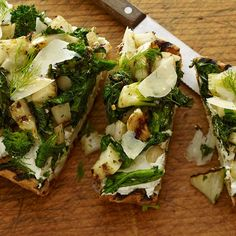 Pair broccoli rabe with fresh fennel, creamy ricotta and shaved Parmesan to make this attractive grilled toast starter.