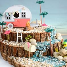 Make your own beach fairy garden with accessories from A.C. Moore! - summer fairy garden - DIY fairy garden