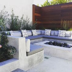 """Just a sneak-peek of one of our latest outdoor spaces and gardens. Ingredients: Concrete, Mahogany Wood, Sunbrella Fabric, Concrete Fire Spheres, Natural…"""