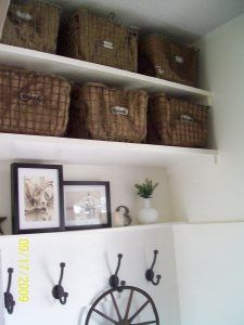 Little Prairie Girl's entryway filled with vintage pool baskets lined with burlap