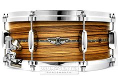 Tama Star Snare Drum Zebrawood 14x6STAR's solid shell snare drums offer three characteristic shell materials, Maple, Mahogany and Zebrawood. Maple and Mahogany models realize not only soft and transparent voice but also light and comfortable response. The Zebrawood model offers an extra super dry sound and clear articulation in high frequency without losing warmer tone. Purchase Here: http://www.drumcenternh.com/tama-star-snare-drum-zebrawood-14x6.html