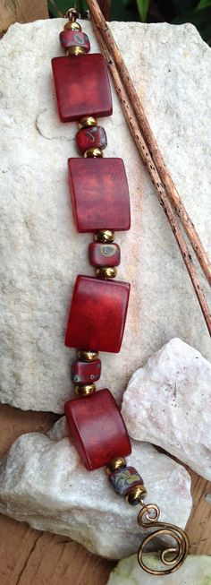 Bracelet. I tried an image search and couldn't find the source. It's gorgeous, though. I love the colors of red in this.