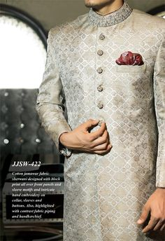 Junaid-jamshed-silver shade Another Jamawar fabric cloth that has been designed with block print all over the Sherwani. The Sherwani has consisted of hand embroidery on the collar, sleeves and on the buttons with a maroon puffed handkerchief. Mens Indian Wear, Indian Groom Wear, Indian Wedding Wear, Indian Men Fashion, Groom Fashion, Men's Fashion, Punjabi Wedding, Pakistani Bridal, Indian Weddings