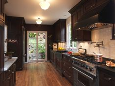 Traditional Kitchen Photos Dark Cabinets, White Countertops Design, Pictures, Remodel, Decor and Ideas
