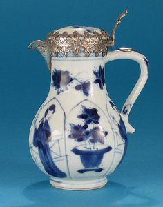 *Click to read about the history and see more detailed images* CHINESE EXPORT SILVER-MOUNTED PORCELAIN JUG (Kangxi, China, c1700)