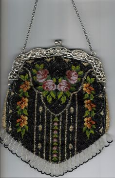 Embroided purse with old beads. Restored by Tineke Nieuwenhuijse