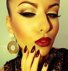 love her nails & makeup but the earrings need to go..