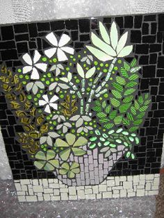 Mosaic wall panel for Kate. Ceramic tile, china and glass.