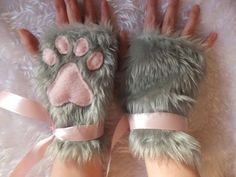 Pair of gloves made from fluffy grey faux fur fabric with fleece paw pads. (Pictured variation is pink paw pads with pink ribbons). These gloves