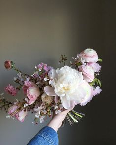 Natural and organic blush pink and white bridal bouquet of cherry blossoms, scabiosa, parrot tulips, ranunculus, spray roses, and peonies by Wild Green Yonder