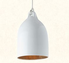 white glazed large ceramic pendant with a shiny gold glaze inside £225 from Caravan