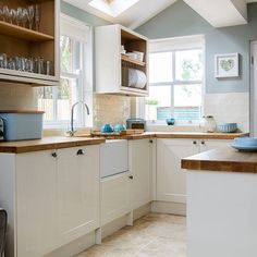 Pale blue and cream kitchen Duck-egg walls, cream Shaker-style units and wooden worktops create a light, fresh feel in this country kitchen. Pale blue kitchen accessories complete the look. Duck Egg Blue Kitchen Walls, Duck Egg Blue Kitchen Accessories, Blue Kitchen Paint, New Kitchen, Kitchen Ideas, Duck Egg Blue And Cream Kitchen, Blue Kitchen Decor, Kitchen Pictures, Kitchen Reno