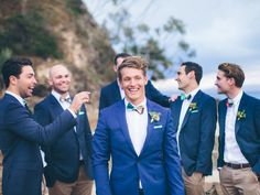 Dare to stear clear of a traditional tux. We adore this cobalt blue suit | A Colourful DIY Beach Wedding In Australia | Weddingbells