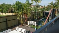 Timber fence around pool area in Aspley north of Brisbane Fence Around Pool, Timber Fencing, Brisbane, Deck, Outdoor Decor, Wood Fences, Wooden Fences, Wooden Fence, Decks