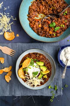 Top your lentil and bean chilli with avocado, sour cream, grated cheese or keep it vegan and opt for salsa and guacamole.
