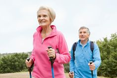 Mature couple doing nordic walking.