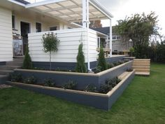 Great example of DIY weatherboard decking. Love the planter boxes. They'd look fantastic in weatherboard!