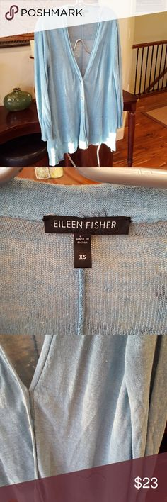 """Eileen Fisher Linen Cardigan Perfect weekend kick around cardigan. Somewhat """"distressed"""" but that is the look. This has been loved but it has lots of wear and love left. Tiny hole in right arm up high. Other tiny hole in back at the bottom. See pictures. Price reflects how well loved this sweater is. Sea Foam blue in color. Silver buttons. Like a cold ocean day. This will hang perfectly on a small frame. Leggings and Top Siders. Eileen Fisher Sweaters Cardigans"""